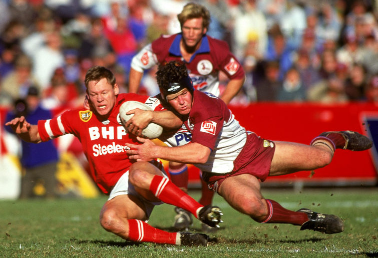 Illawarra's Rod Wishart brought down by Manly's Mark Carroll.
