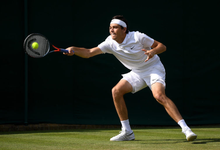 Taylor Fritz of The United States plays a forehand
