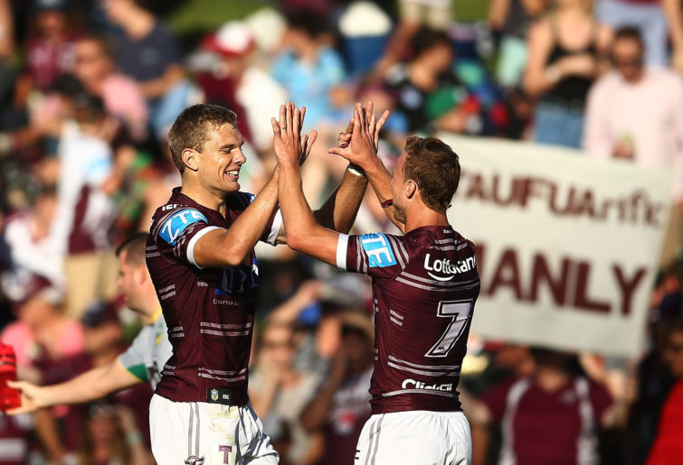 Tom Trbojevic and Daly Cherry-Evans celebrate.