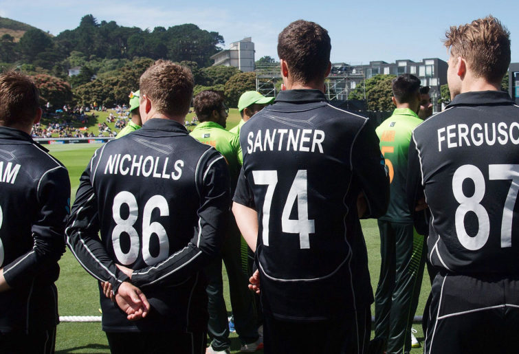 om Latham, Henry Nicholls, Mitchell Santner, and Lockie Ferguson wait to walk onto the field