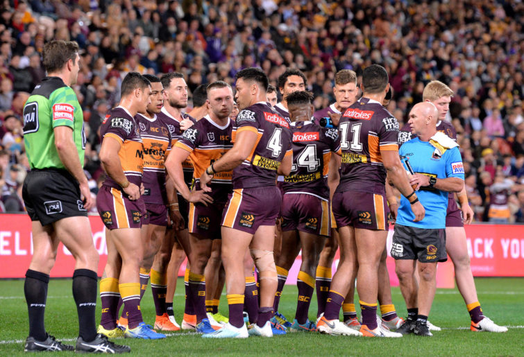 The Brisbane Broncos after a try is scored against them.