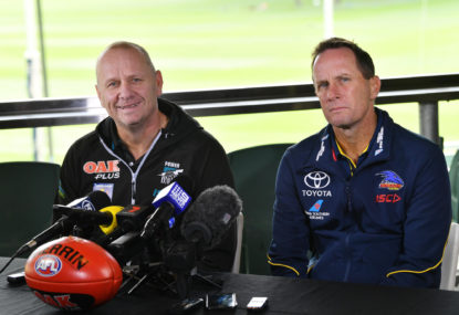 Which South Australian club coach is under more pressure?