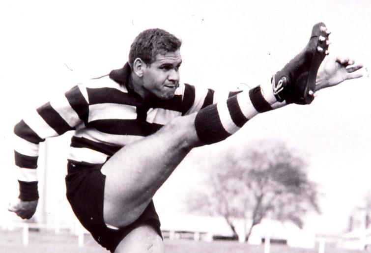 Graham 'Polly' Farmer kicks a ball.