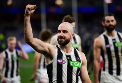 Magpies scrape past Demons to stay in top-four battle