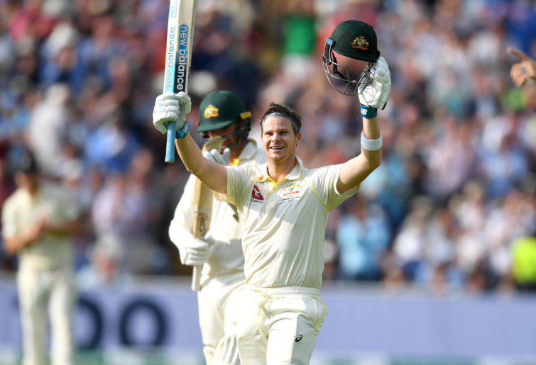 Steve Smith celebrates reaching his century.