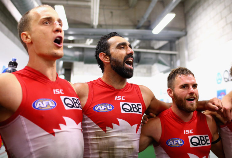 Ted Richards, Adam Goodes and Ben McGlynn sing.