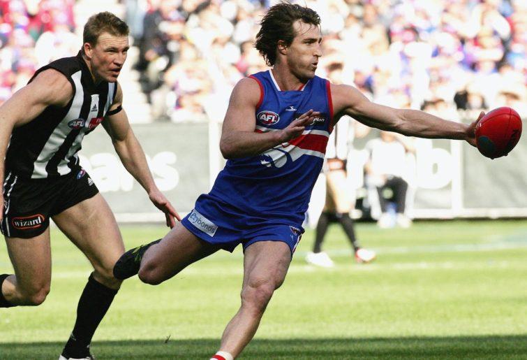 Scott West evades Nathan Buckley.