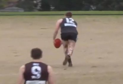 Local footy legend drills one in from outside the 50