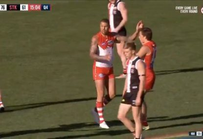 Buddy Franklin sneaks up on Shane Savage in extraordinary 300th