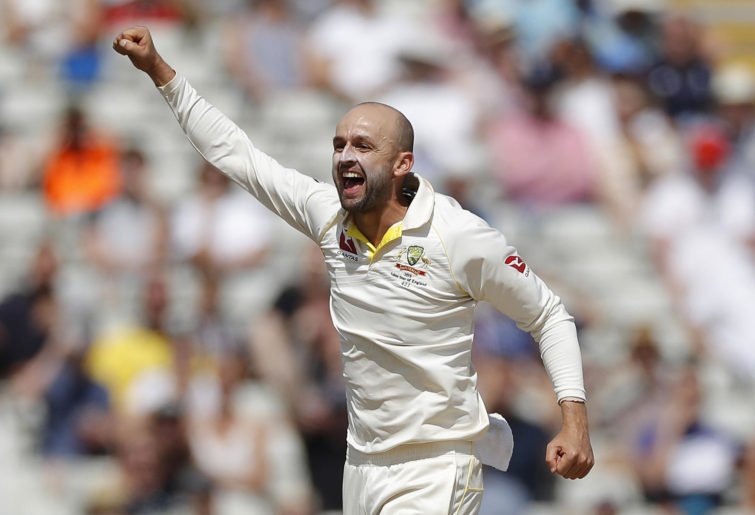 Nathan Lyon celebrates taking a wicket