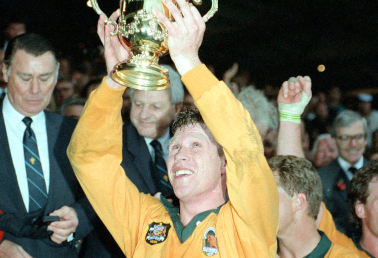 Nick Farr-Jones celebrates with the Rugby World Cup Trophy