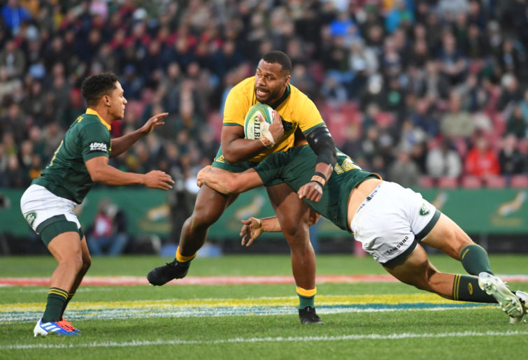 Samu Kerevi of the Wallabies is tackled