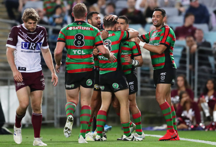 Cody Walker and the Rabbitohs celebrate.