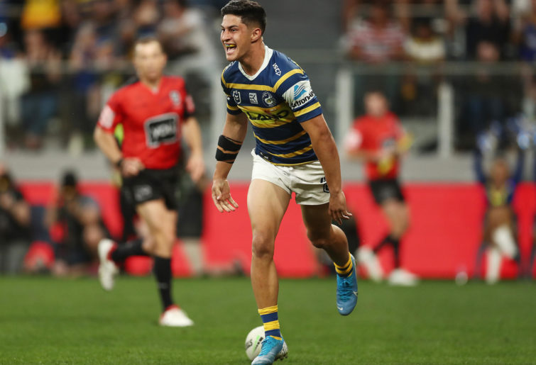 Dylan Brown of the Eels scores a try.