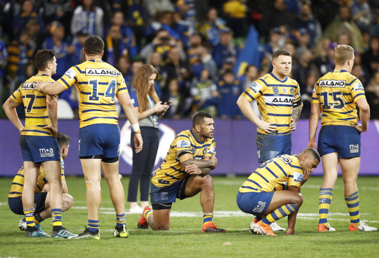 Parramatta Eels players looking dejected after their semi-final loss.