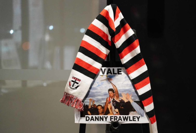 A scarf hangs for Danny Frawley