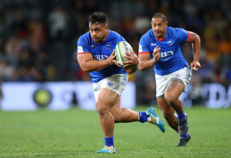 Ray Niuia of Samoa runs the ball