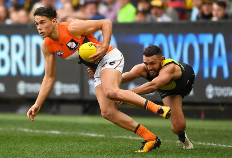 Josh Kelly is tackled by Shane Edwards