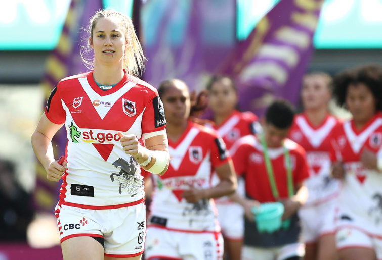 Kezie Apps leads the Dragons NRLW side onto the ground.
