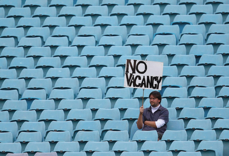 NRL fan in empty stadium.