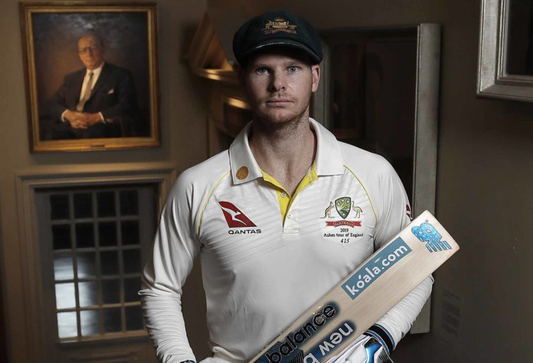 Steve Smith next to a picture of Don Bradman
