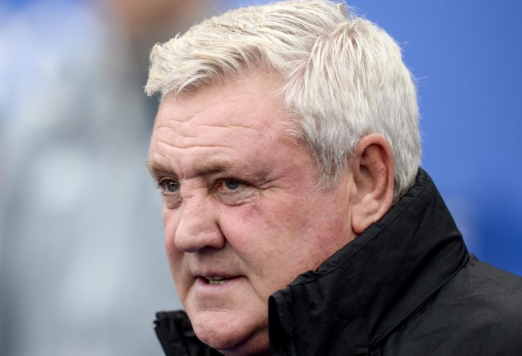 Newcastle manager Steve Bruce watches on.