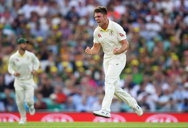 Mitchell Marsh celebrates taking a wicket