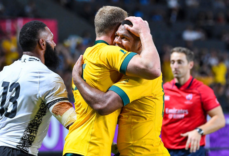 Reece Hodge and Kurtley Beale celebrate a try