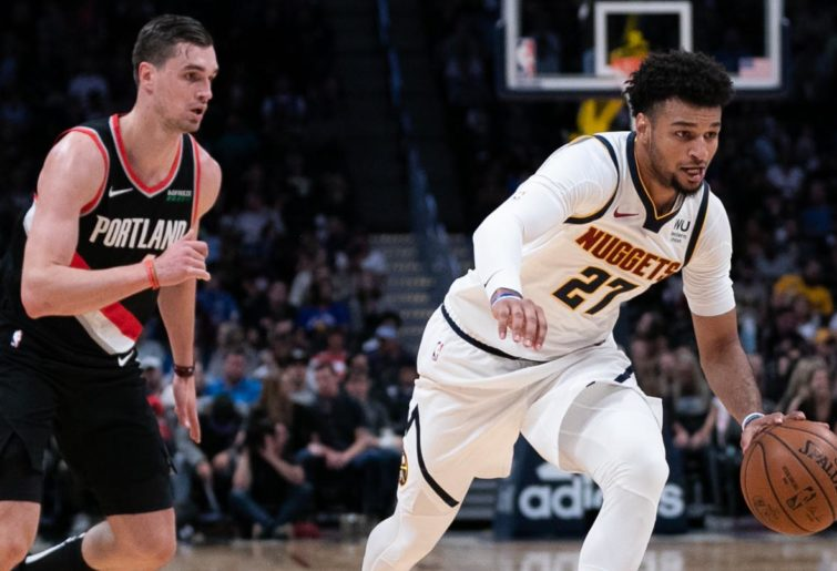 Jamal Murray of the Denver Nuggets brings the ball past Mario Hezonja of the Portland Trail Blazers