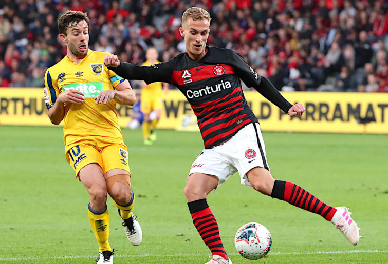 Tass Mourdoukoutas from the Western Sydney Wanderers holds off the Mariners' Thomas Oar