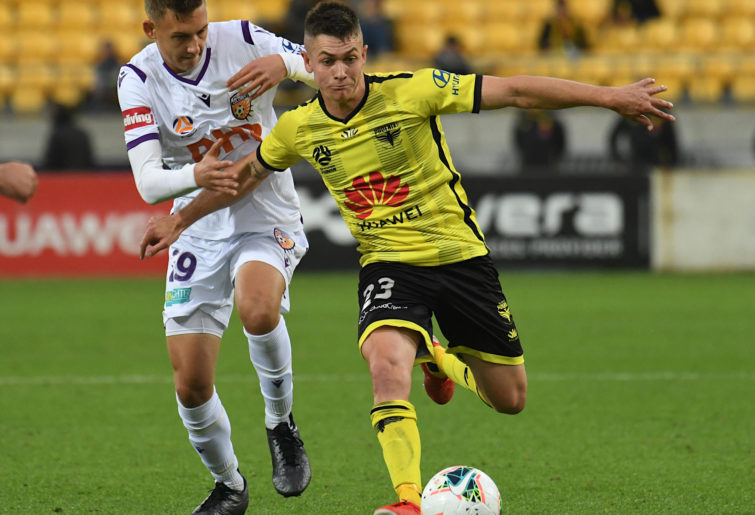 Wellington Phoenix's Walter Scott dribbles the ball.