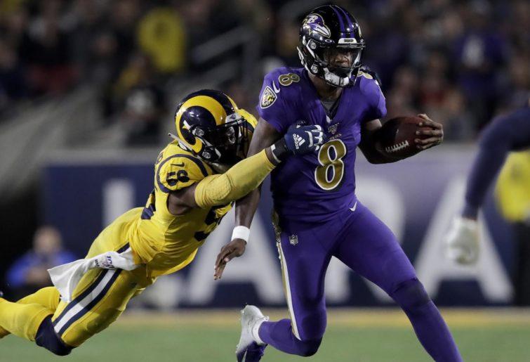 Lamar Jackson runs and is tackled