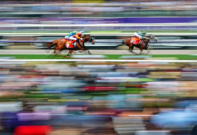 horses pass the post at Flemington