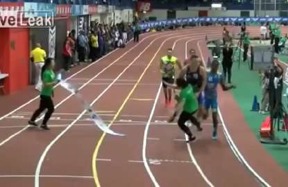 Track marshal 'Wham Sauced' during 400m event
