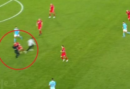 Security guard takes out Poland defender while chasing pitch invader