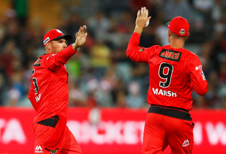 Aaron Finch celebrates with Shaun Marsh of the Melbourne Renegades.