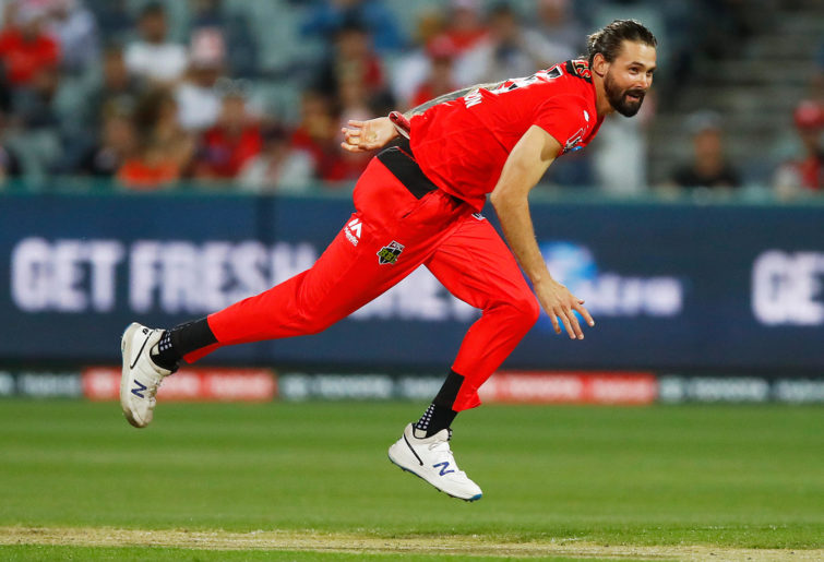 Kane Richardson of the Renegades bowls during the Big Bash League