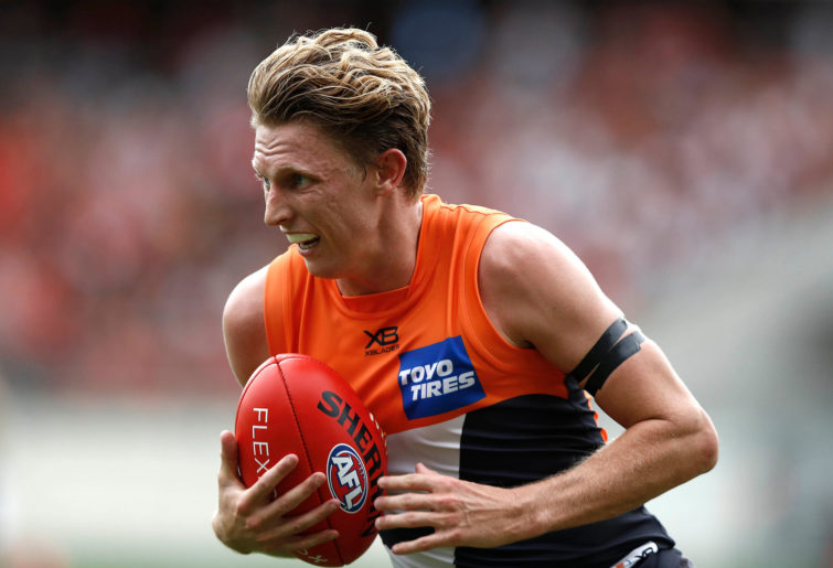 Lachie Whitfield of the GWS Giants carries the ball.
