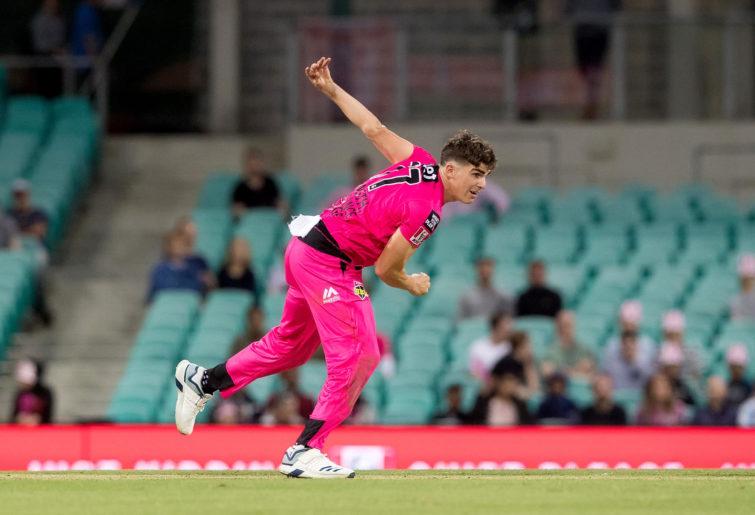 Sydney Sixers player Sean Abbott bowling