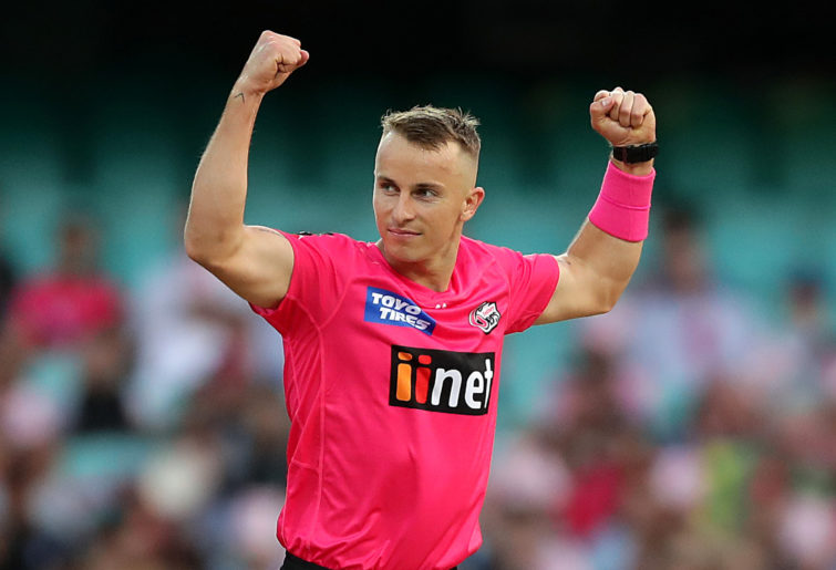 Tom Curran of the Sixers celebrates taking a wicket