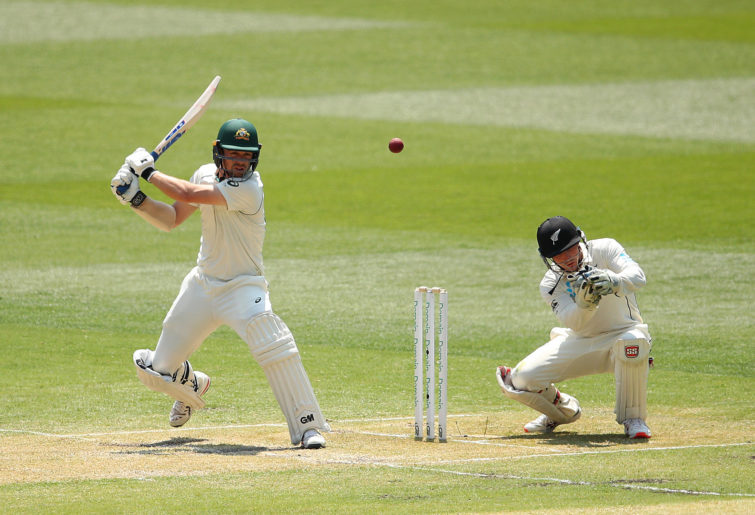 Travis Head of Australia (L) bats during day two