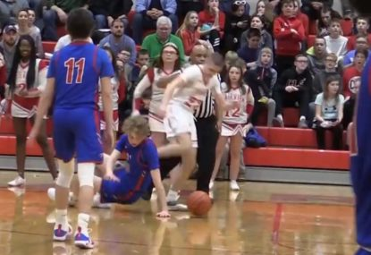 Highschool basketballer KICKED on the ground in shocking play