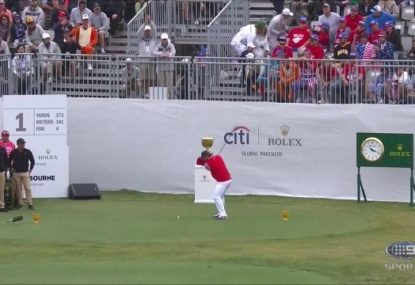 Everyone cheers as Patrick Reed's tee shot fittingly goes straight into the bunker