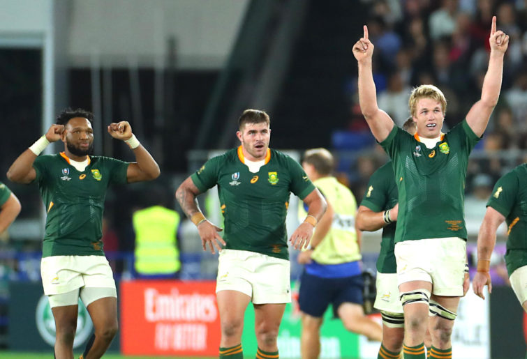 Pieter-Steph du Toit, Lukhanyo Am and Malcolm Marx celebrate Cheslin Kolbe's try in the Rugby World Cup final