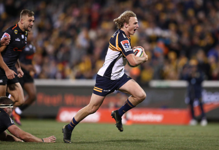 Joe Powell of the Brumbies runs in for a try