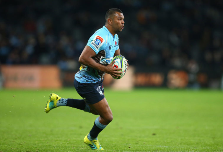 Kurtley Beale of the Waratahs runs the ball