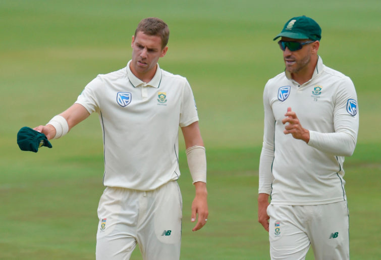 South Africa's captain Faf du Plessis (R) talks wit South Africa's Anrich Nortje (L)