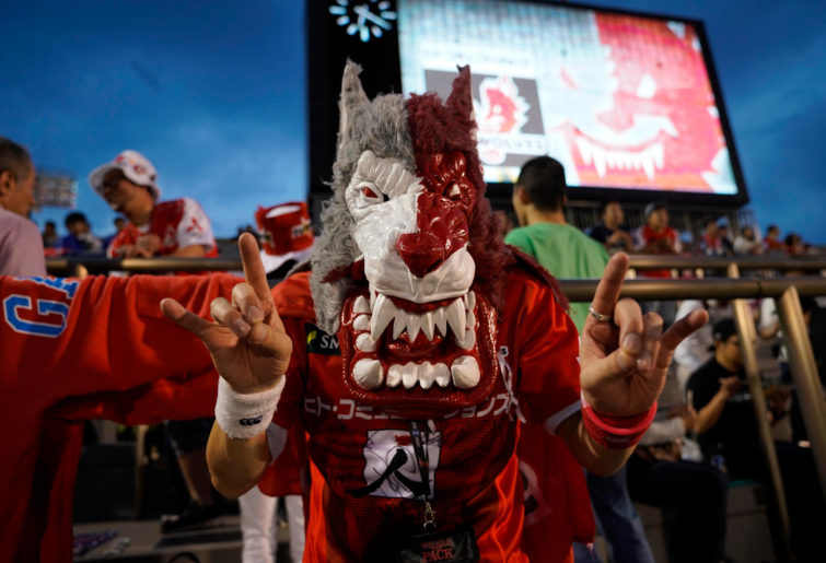 A Sunwolves supporter poses for photographs