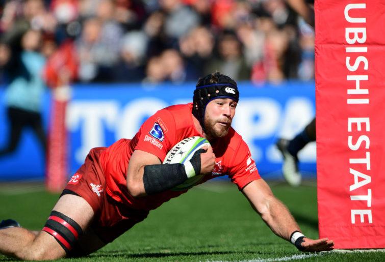 Sunwolves' lock Tom Rowe scores a try