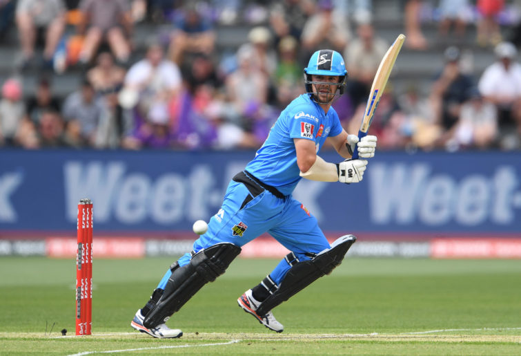 Travis Head of the Strikers plays a shot during the Big Bash League